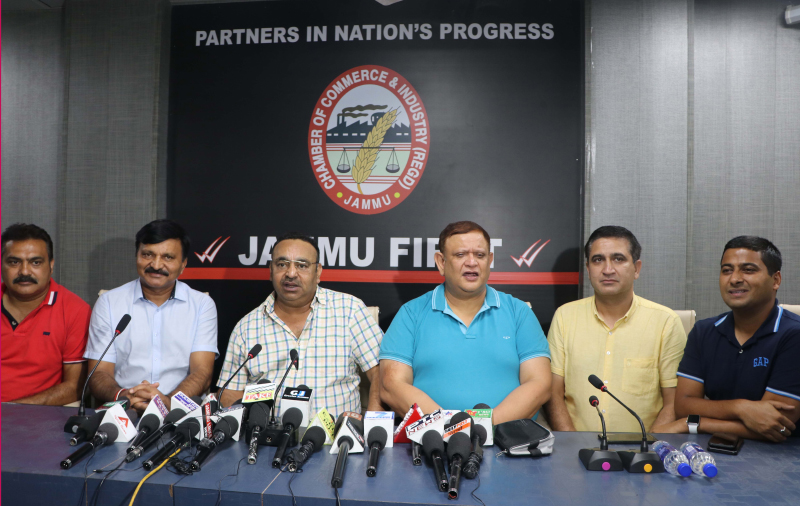 JCCI president, Rakesh Gupta, flanked by secy general and others talking to media-persons in Jammu on Thursday. — Excelsior/ Rakesh