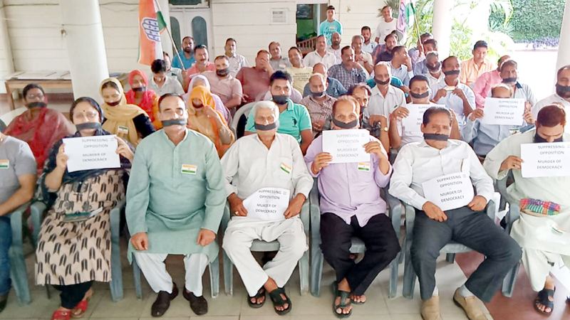 Congress leaders and activists staging silent protest at Paloura in Jammu on Saturday.