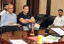 DDC Nazim Zai Khan chairing a meeting at Ramban on Sunday.