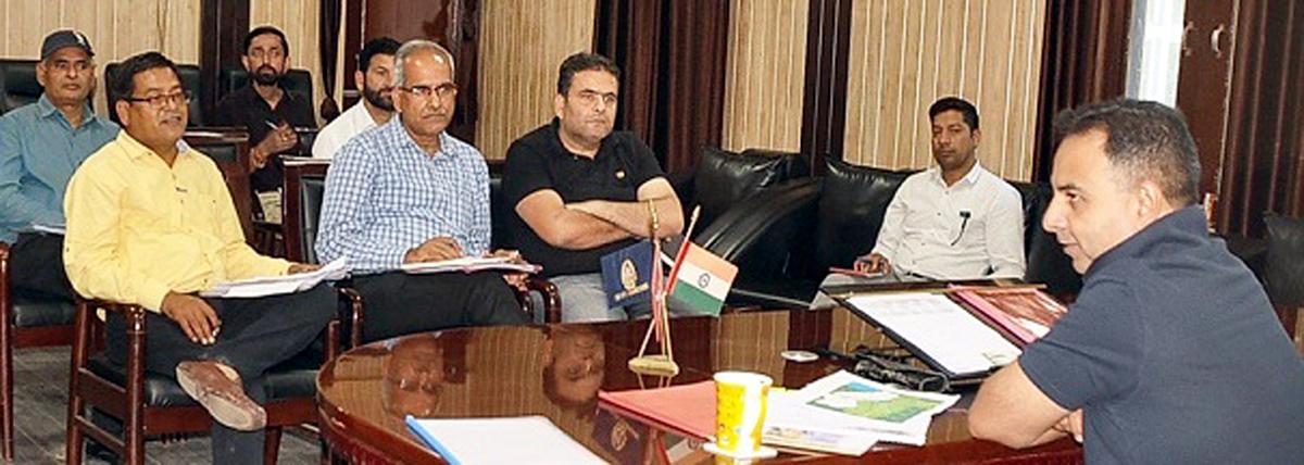 DDC Nazim Zai Khan chairing a meeting at Ramban on Sunday.