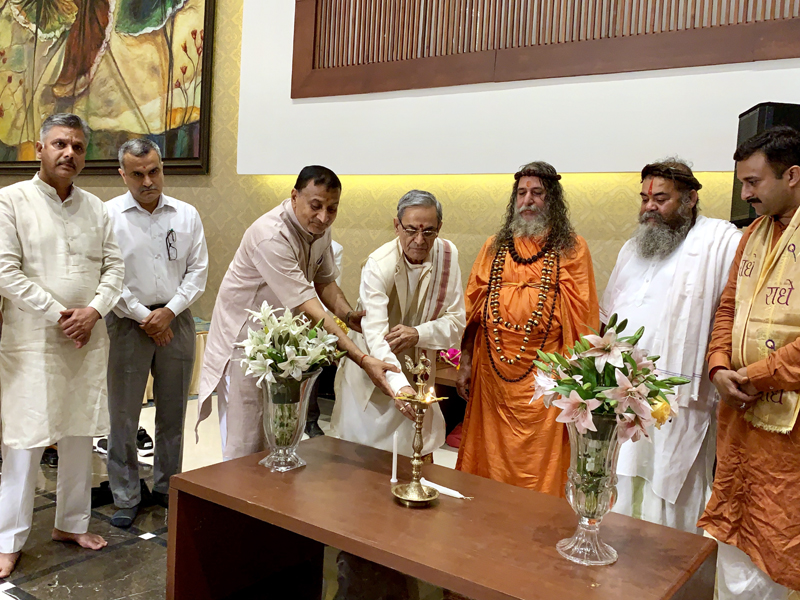 Guests lighting ceremonial lamp during inaugural of Sanskrit Day function at Jammu on Friday.