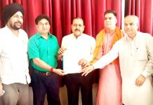 BJP spokesperson Balbir Ram Rattan submitting memorandum to Union Minister, Dr Jitendra Singh at Jammu on Sunday.