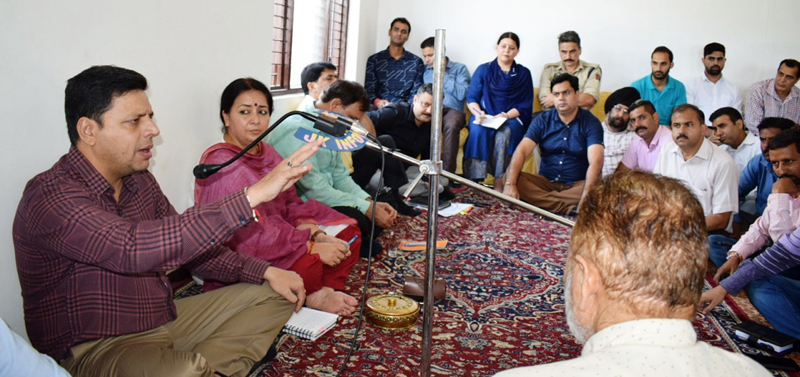 Divisional Commissioner Sanjeev Verma interacting with people in Reasi district on Tuesday.