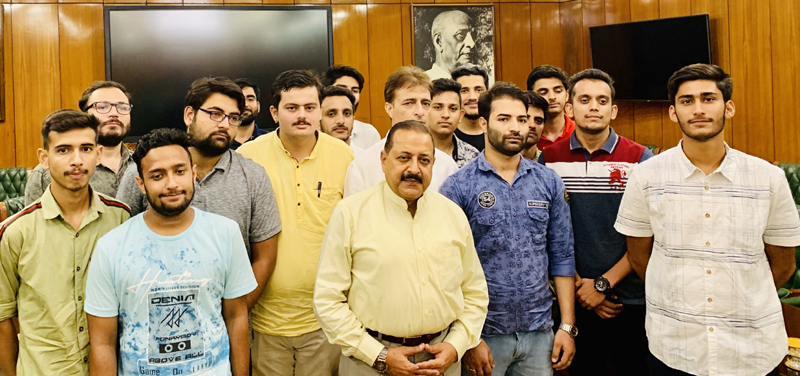 Union Minister Dr Jitendra Singh with a group of Delhi based students from remote areas of Jammu and Kashmir, at North Block New Delhi on Thursday.