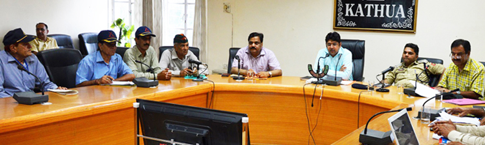 Deputy Commissioner Dr Raghav Langer chairing a meeting at Kathua on Friday.