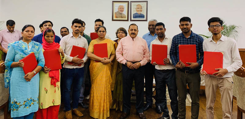 Union Minister Dr Jitendra Singh posing with the survivors of the deceased Government employees, after handing them over appointment letters on compassionate grounds, at North Block, New Delhi on Thursday.