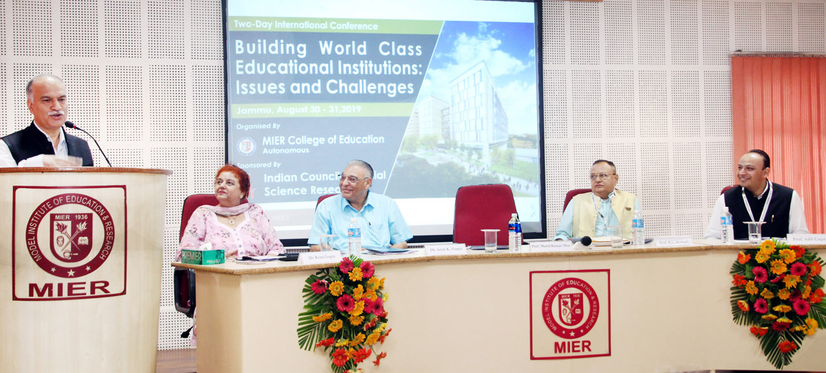 JU VC delivering presidential address in conference at MIER.