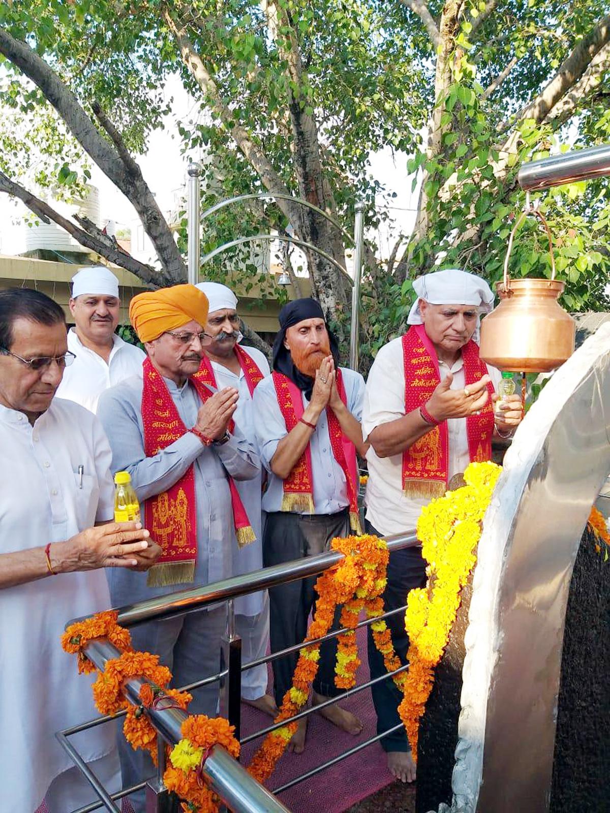 Devotees offering prayers at Shani Dev Temple at Gandhi Nagar on Saturday.