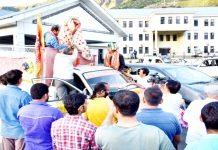 DC Angrez Singh Rana and others welcoming Annual Charri, Akhand Jyot of Shri Machail Mata Yatra at Kishtwar.
