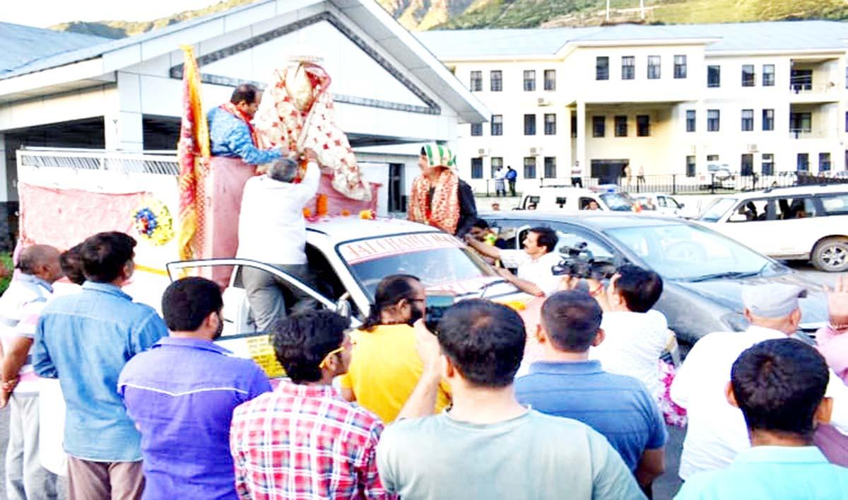 DC Angrez Singh Rana and others welcoming Annual Charri, Akhand Jyot of Shri Machail Mata Yatra at Kishtwar.