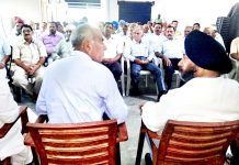 Former Minister and Congress leader, Manjit Singh addressing a meeting at Vijaypur on Sunday.