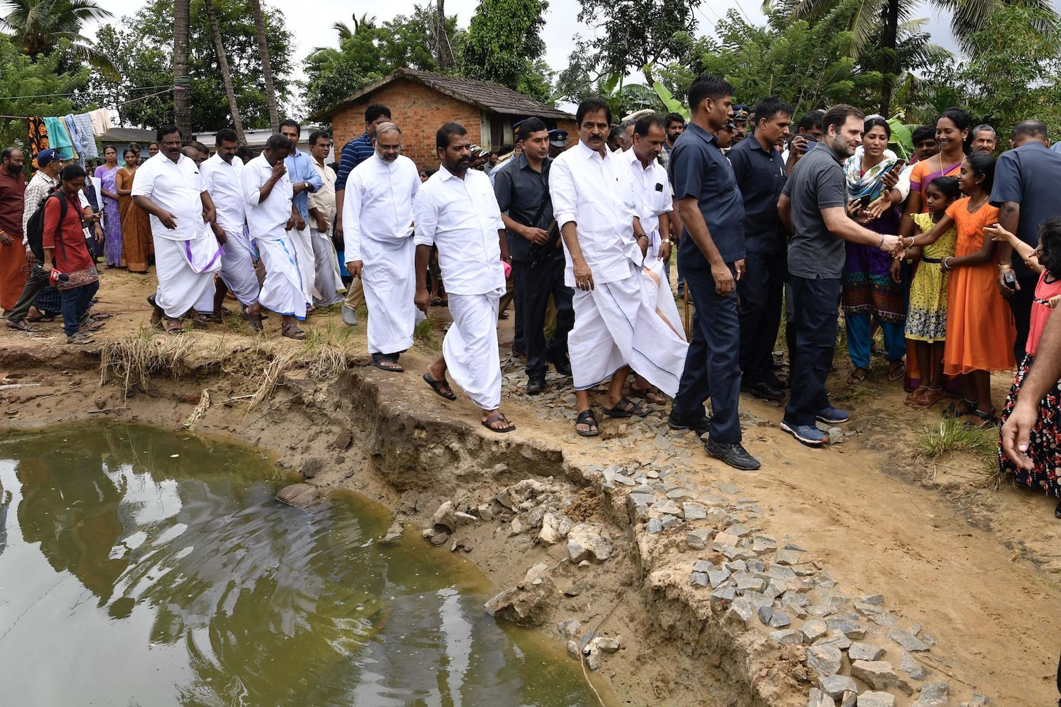 Congress leader and Wayanad MP Rahul Gandhi with flood victim families at flood relief camp at Chaligandha, Payyampally village in Wayanad Parliamentary segment in Kerala on Wednesday. (UNI)