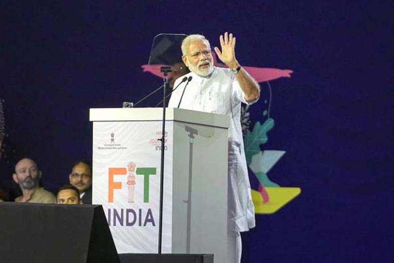 Prime Minister Narendra Modi addresses during the launch of Fit India Movement on National Sports Day, at Indira Gandhi Indoor Stadium in New Delhi on Thursday.