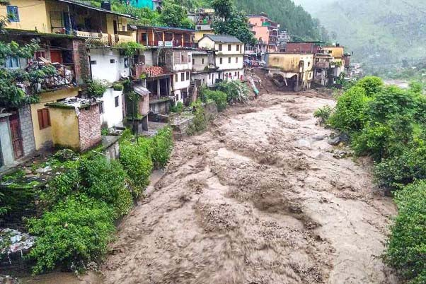 Flood water gush down after a cloudburst in Chamoli district. A woman was buried alive while five others were trapped in the rubble as landslides triggered by heavy rains hit three different places in the watershed area of Chuflagad, a tributary of Nandakini River in Uttarakhand's Chamoli district.