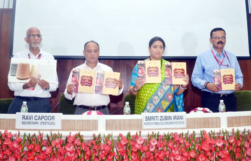 Union Minister for Women and Child Development and Textiles Smriti Irani releasing the publication at the MoU signing ceremony of Ministry of Textiles with 18 States Governments to provide skill training candidates in Textiles sector under 'Samarth', a scheme for capacity building in textiles sector, in New Delhi on Wednesday. (UNI)