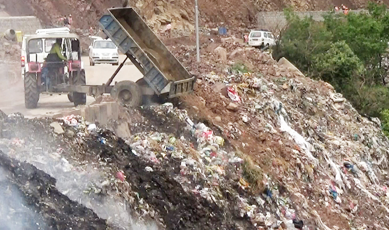 Garbage being dumped near National Highway at Jakhani.