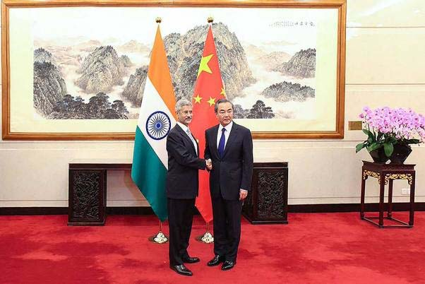 External Affairs Minister Subrahmanyam Jaishankar shakes hands with Chinese Foreign Minister Wang Yi during a meeting at Diaoyutai State Guesthouse, in Beijing.