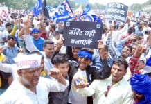 A huge rally by the members of various Dalit organisations from across the country being organised in protest against the demolition of a temple of Guru Ravidas in Tugalkabad area in the capital, at Ram Lila ground in New Delhi on Wednesday. (UNI )
