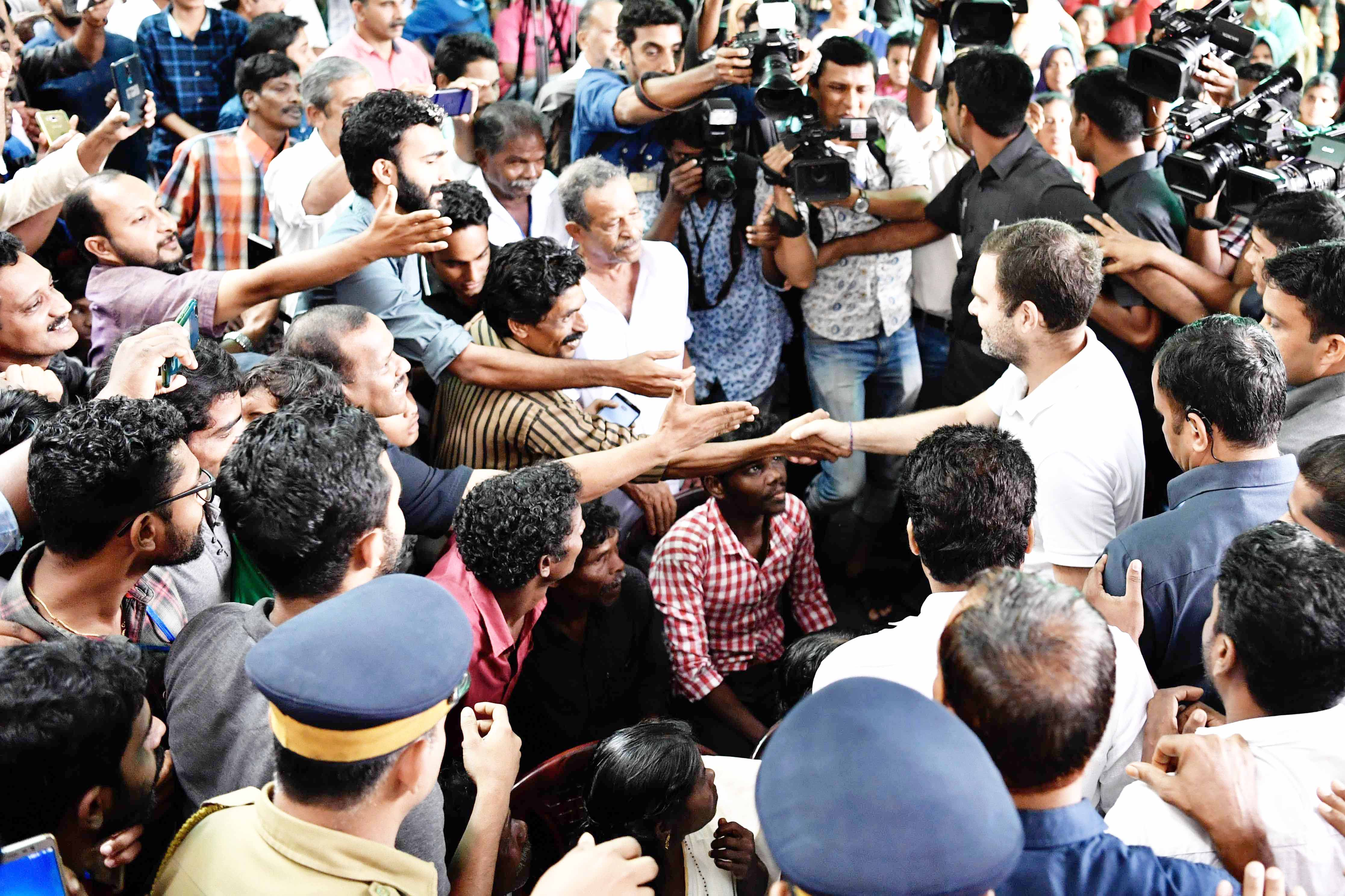 Congress leader Rahul Gandhi interacting with flood victims at Kaithapoil Flood Relief Camp at Thamrassaery in Kozhikode on Monday. (UNI)