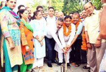 Former Minister, Sat Sharma kick-starting construction of lane & drain in Ward 18 on Friday.