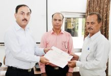 Dr. S.D Singh Jamwal, Director Sher-I-Kashmir Police Academy giving certificate to a participant in a workshop at Udhampur.