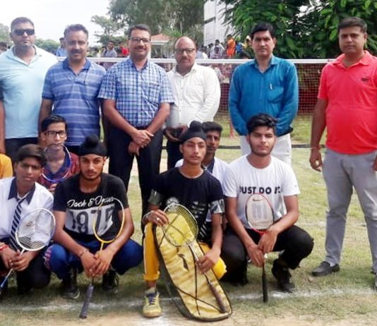 Winners of Badminton title posing for a group photograph along with dignitaries and officials in Samba.