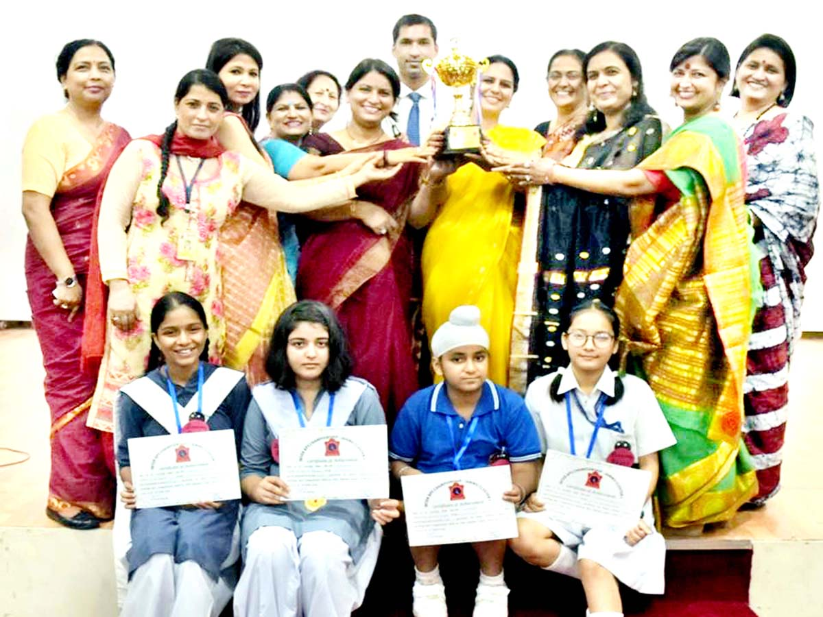 Winners of Spell-Bee competition posing for a group photograph in Jammu.