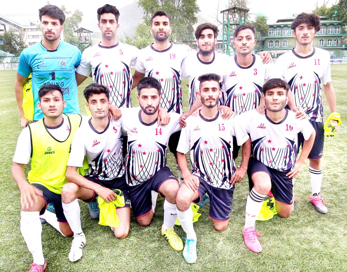 Winning team posing for a group photograph during State Football League in Srinagar.