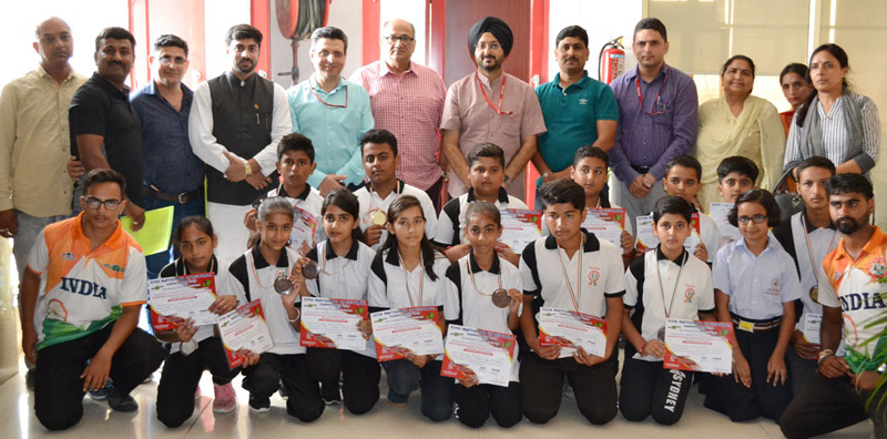 Speedball players posing along with CEO SMVDSB Simrandeep Singh during felicitation function on Monday.
