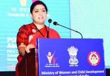 Union Minister for Women & Child Development and Textiles, Smriti Irani addressing at the felicitation ceremony of Good Performing States and Districts under Beti Bachao Beti Padhao programme, in New Delhi on Friday.