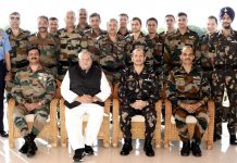 Governor and Air Vice Marshal with officers of 43rd Higher Air Command Course posing for group photograph on Friday.