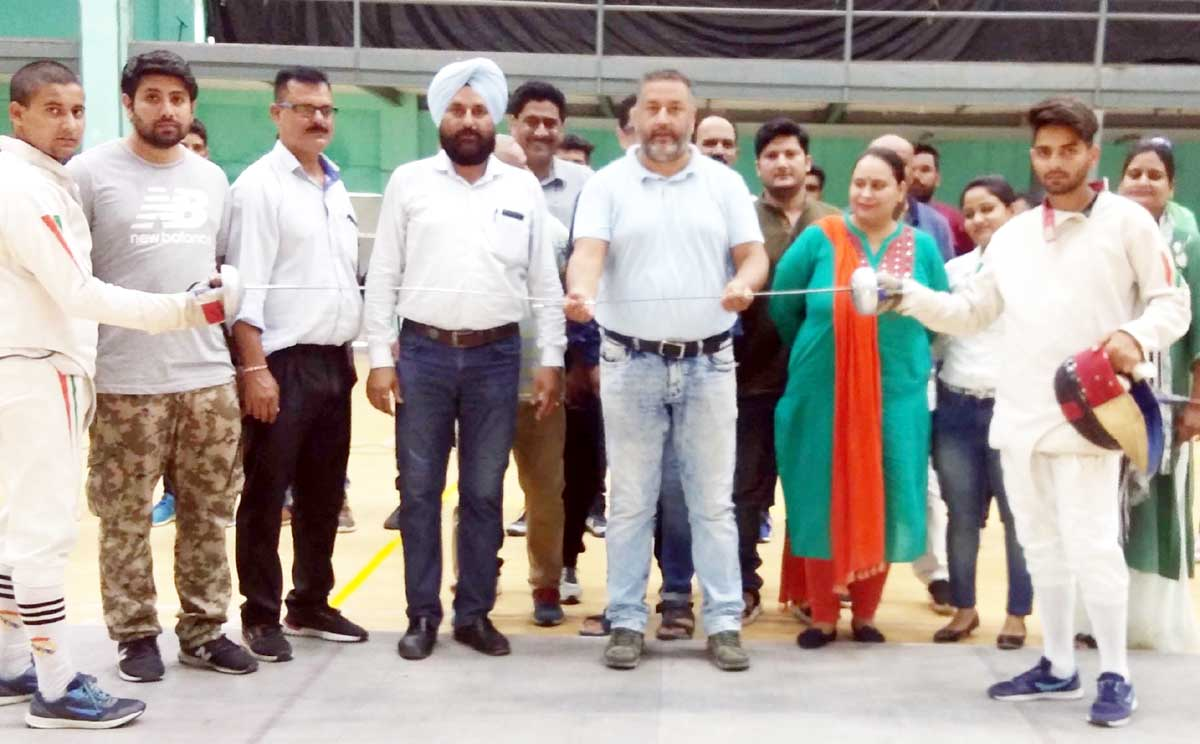 Dr Daud Iqbal Baba, Director, Directorate of Sports & Physical Education, JU declaring open Fencing Championship on Tuesday.