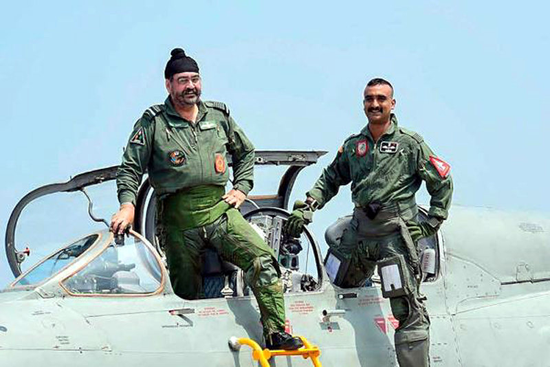 Air Chief Marshal BS Dhanoa and Wing Commander Abhinandan Varthaman, the IAF pilot who became the face of a tense military confrontation between India and Pakistan in February, pose for a photograph after a sortie on the MiG 21 jet, at Airforce Station, Pathankot.