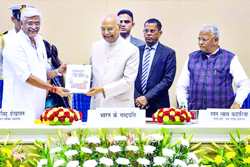 President Ram Nath Kovind being presented with the first copy of 'The Swachh Bharat Misiion Grameen' by Union Minister Gajendra Singh Shekhawat during the 'Swachhata Mahotsava', in New Delhi on Friday.
