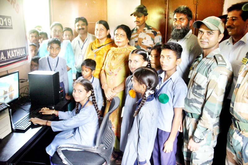 Students at an IT Lab established by Army in Government school.