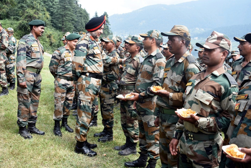 Northern Command chief Lt Gen Ranbir Singh inter-acting with troops.