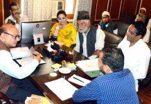 Advisor K Skandan interacting with a deputation in Srinagar on Monday.