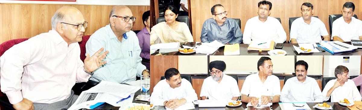 Advisors to Governor KK Sharma and K Skandan chairing a meeting on Monday.