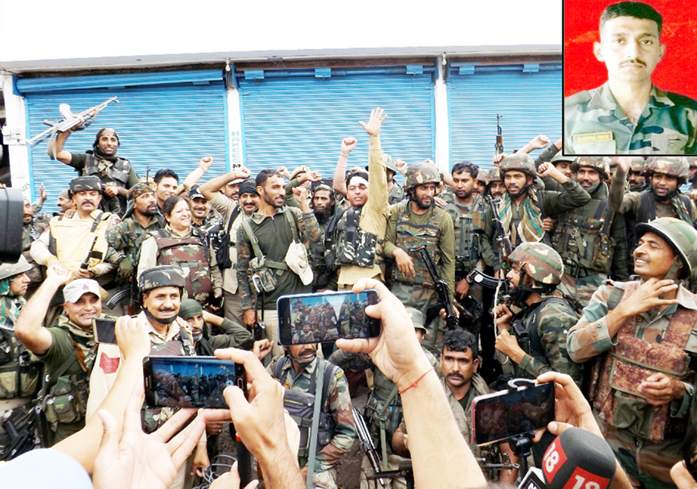 Jubilant security personnel chant 'Bharat Mata Ki Jai' after eliminating three militants at Batote on Saturday. (Inset) Martyr Rajinder Singh. —Excelsior/Parvaiz Mir