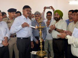 Advisor Vijay Kumar lighting the ceremonial lamp during inauguration of GNM at Bailey in Udhampur.