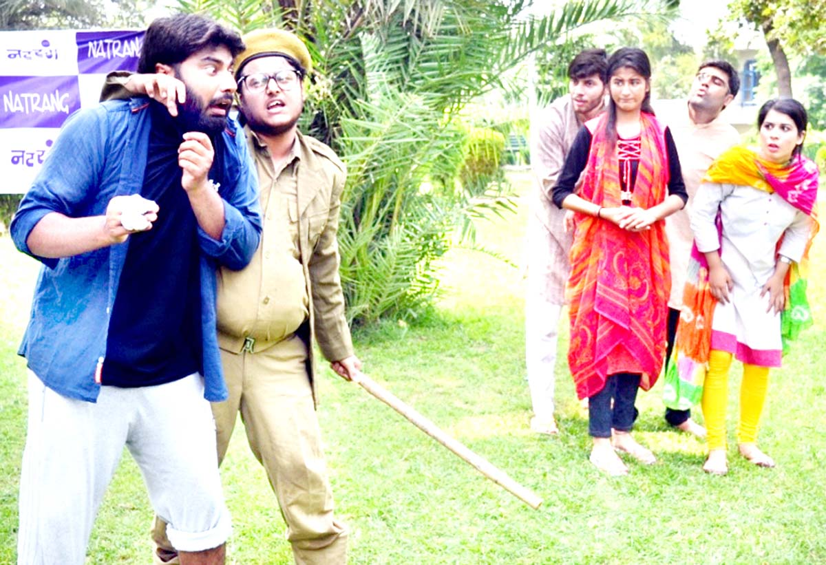 A scene from Hindi play 'Girgit' staged at Jammu on Sunday.