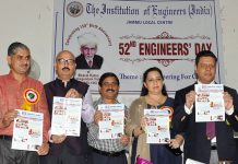 Divisional Commissioner Jammu, Sanjeev Verma and other dignitaries releasing newsletter 'IEI Jammu News' on Sunday.