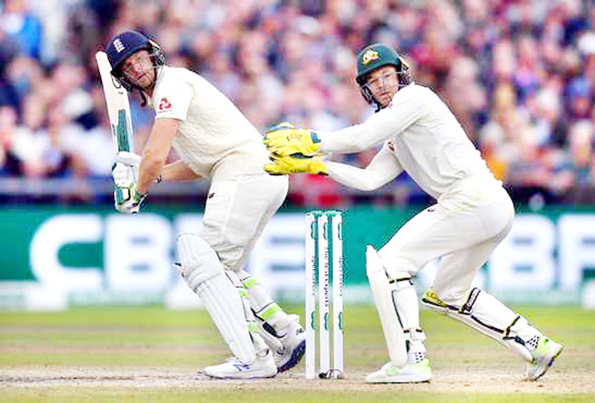Jos Buttler hitting a shot during match against Australia at Manchester.