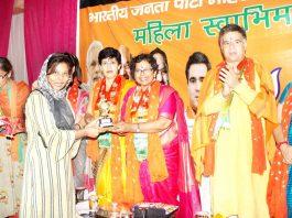 BJP Mahila Morcha national President, Vijaya Rahatkar honouring a woman at Jammu on Sunday. -Excelsior/Rakesh