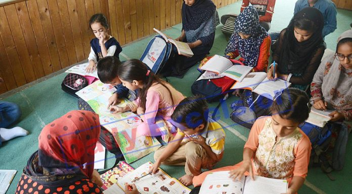 Children study at a private home tuition centre in Srinagar. —Excelsior/Shakeel