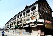 A deserted view of Amirakadal road in Srinagar.(UNI)