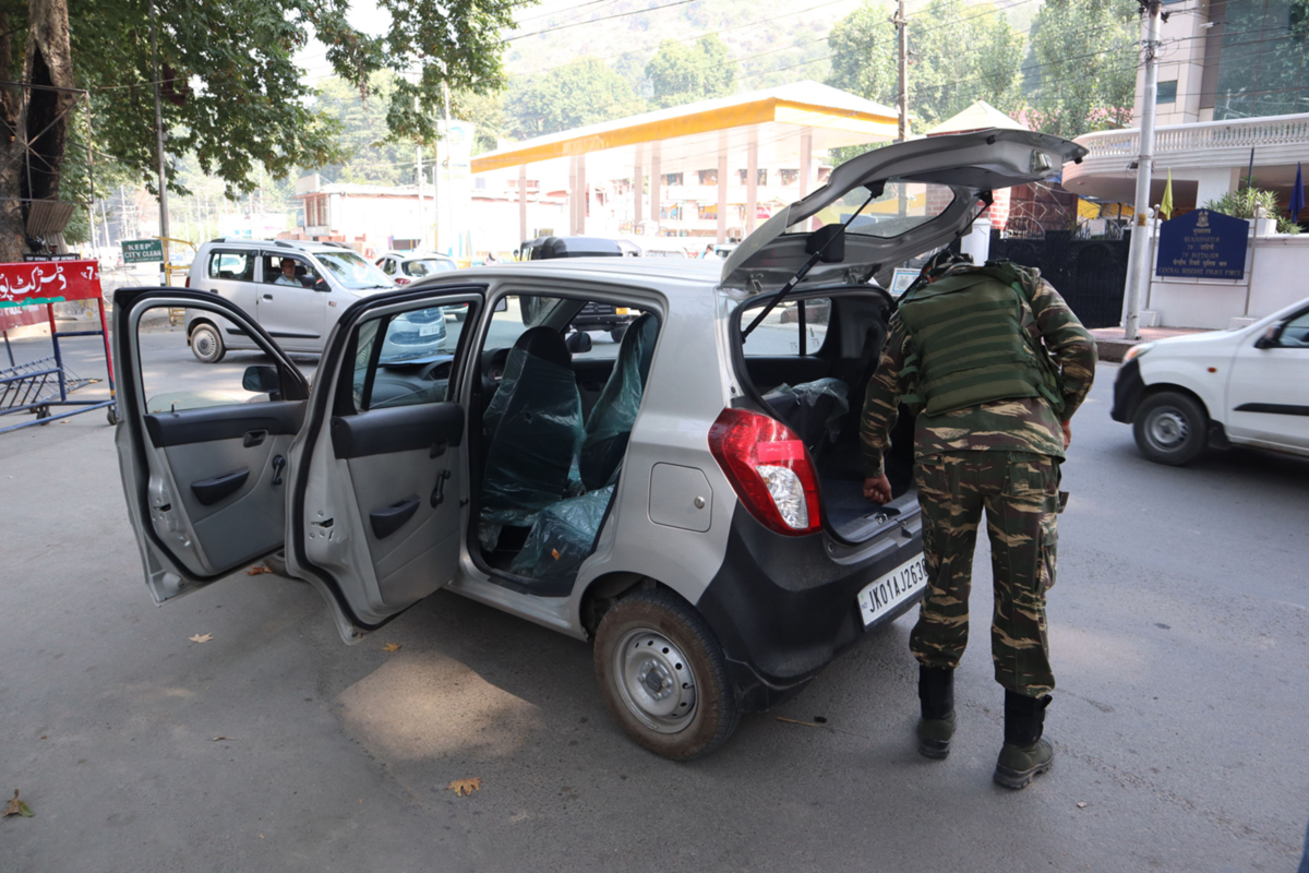Security forces checking a vehicle in Srinagar on Tuesday. -Excelsior/Shakeel