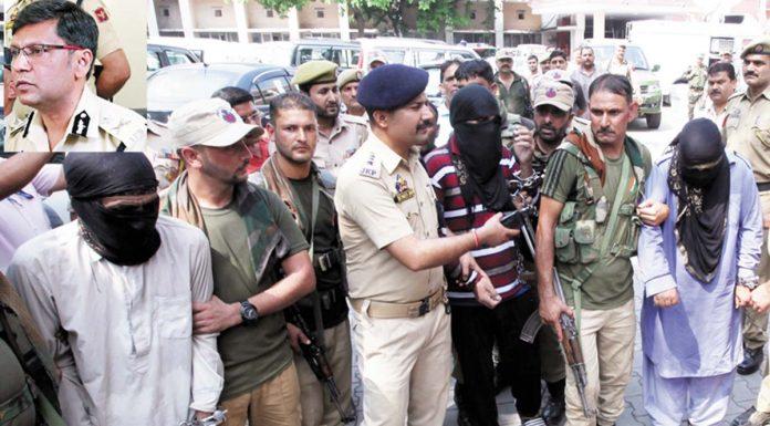 Militants in custody of police. (Inset) Mukesh Singh, IGP Jammu. —Excelsior/Rakesh