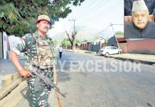 Security forces deployed on Gupkar Road after PSA was slapped on Dr Farooq Abdullah (inset) in Srinagar. -Excelsior/Shakeel