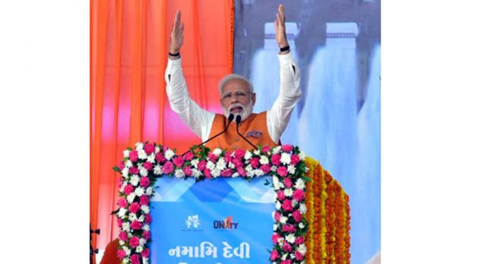 Prime Minister Narendra Modi addressing a rally on the occasion of his 69th birthday in Kevadiya on Tuesday.(UNI)
